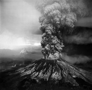 Aerial view of the May 18, 1980, eruption of Mount St. Helens as seen from the southwest. This column of ash and volcanic gas reached a height of about 18.2 km (60,000 ft).