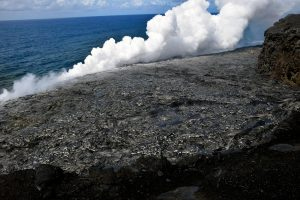 The episode 61g flow continues to enter the ocean and build the delta at the Kamokuna ocean entry. Small streams of lava along the front of the delta interact with the ocean and produce a large steam plume and occasional littoral bursts. There were no large delta cracks visible, but a surface flow covering part of the delta (silver lava) could have covered any in the area. Photo taken Friday, June 16, 2017 courtesy of USGS/HVO