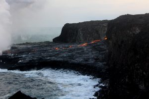 This photo from June 25 shows the established lava channel at 6:49 pm HST, hours after the firehose activity. Today (June 26) HVO observers did not see any active surface breakouts on the delta and the channel has tubed over, but some narrow streams of lava were spilling into the ocean. The delta had lost some small chunks, but there was no evidence seen of a large-scale delta collapse. Photo taken Monday, June 26, 2017 courtesy of USGS/HVO