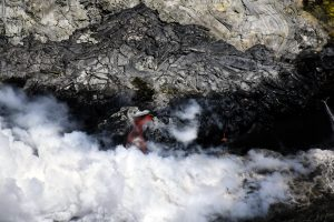At the front edge of the delta, a large tube-fed stream of lava enters the ocean. Only occasional glimpses of flowing lava could be seen through the thick steam plume produced by the interaction hot lava and cool sea water. A few smaller lava streams also entered the ocean, including the one to the right of the main stream shown here. Photo taken Thursday, June 29, 2017 courtesy of USGS/HVO