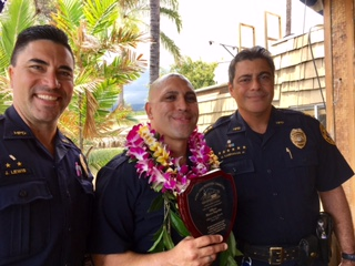 Photo is at Huggo's with Detective Scotty Lewis, Officer Segobia, and Assistant Chief Mitchell Kanehailua, (June 7) Photo: Courtesy of Sherry Bracken