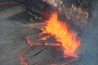 This telephoto image from January 19, 2017, shows spattering along a down-welling section of Kīlauea Volcano's summit lava lake. The main area of spattering was about 10 m (32 ft) high, but some lava fragments were thrown even higher. Depending on the lava lake level, spattering on the lava lake surface is sometimes visible from the Jaggar Museum Overlook in Hawaiʻi Volcanoes National Park. USGS photo, M. Patrick