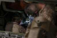 Assault Amphibian crewman conduct maintenance inside the engine bay of an AAV in the well deck of USS San Diego (LPD 22) during the 15th Marine Expeditionary Unit's Certification Exercise, May 31, 2017. CERTEX is the final at-sea training period to certify the 15th MEU and America Amphibious Ready Group in preparation for their upcoming deployment. The Marines are with the 15th MEU Battalion Landing Team. (U.S. Marine Corps photo by Cpl. Timothy Valero)