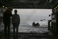 Navy well deck personnel aboard USS San Diego (LPD 22) wait to direct an Assault Amphibious Vehicle as it enters the well deck during the 15th Marine Expeditionary Unit's Certification Exercise, May 31, 2017. CERTEX is the final at-sea training period to certify the 15th MEU and America Amphibious Ready Group in preparation for their upcoming deployment. The Marines are with the 15th MEU Battalion Landing Team. (U.S. Marine Corps photo by Cpl. Timothy Valero)