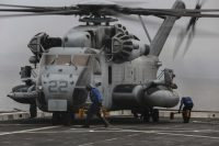 Crew assigned to the flight deck aboard USS San Diego (LPD 22) hurry to secure a CH-53E Super Stallion after landing to deliver personnel and equipment for the Certification Exercise, May 31, 2017. CERTEX is the final at-sea training period to certify the 15th Marine Expeditionary Unit and America Amphibious Ready Group in preparation for their upcoming deployment. The aircraft is with Marine Medium Tiltrotor Squadron 161 (Reinforced) attached to the 15th MEU. (U.S. Marine Corps photo by Cpl. Timothy Valero)