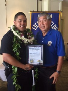 Officer Wyatt Kaili-Leong with Club President Curtis Chong