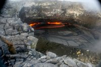 An example time-lapse image from the camera shown in the previous photo. This image is from September 14 and shows typical activity in the lava pond, with spattering along the western pond margin. Photo taken Thursday, September 21, 2017 courtesy of USGS/HVO