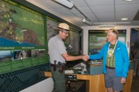 Chief Ranger John Broward shakes hands with Dave Parker of McLean, VA who completed his quest to visit all 59 National Parks on Wednesday. NPS Photo by Janice Wei