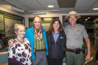 "Left to right: Elizabeth Fien, Executive Director of the Friends of Hawaii Volcanoes National Park; Dave Parker ""59er""; , Margot Griffith, Executive Director of the Hawai'i Pacific Parks Association; and Hawaii Volcanoes' Acting Superintendent and Chief Ranger John Broward smile for a photo in the Kīlauea Visitor Center. NPS Photo by Janice Wei"