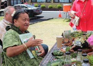 Aunty Ka'ohu Monfort demonstrates lā'au lapa'au at the 2017 Cultural Festival. NPS Photo/Jay Robinson