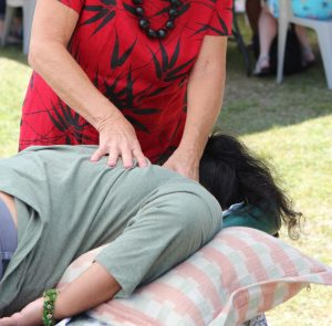 Lomi massage demonstrated in the park. NPS Photo/Jay Robinson