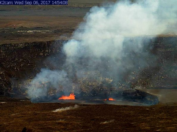 A USGS Hawaiian Volcano Observatory webcam captured this image of spattering on Kīlauea Volcano's summit lava lake on September 6, 2017. In concert with summit inflation, the lake level had risen to 16.5 m (54 ft) below the vent rim, bringing it into view from the Jaggar Museum Overlook in Hawaiʻi Volcanoes National Park. When inflation switched to deflation the next day, the lava lake level dropped about 15 m (49 ft). HVO webcam images of Kīlauea can be viewed at https://volcanoes.usgs.gov/volcanoes/kilauea/multimedia_webcams.html