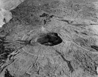 This view of Halema'uma'u as it appeared in the 1917 relief model by George Carroll Curtis shows fine details around the crater, including the first road for automobiles, which ended near the crater rim. The light-colored circular feature around Halemaʻumaʻu is a nearly continuous escarpment along which subsidence occurred. Photo by Burr A. Church.