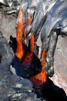 Geologists in the field on Friday, December 29, found active lava breakouts roughly 330 m (0.2 mile) out from the base of Pūlama Pali, and approximately 2.9 km (1.8 miles) from the emergency road. As these pāhoehoe fingers reached the edge of a ground crack, lava cascaded over a meter (yard) down. Photo taken Friday, December 29, 2017 courtesy of U.S. Geological Survey