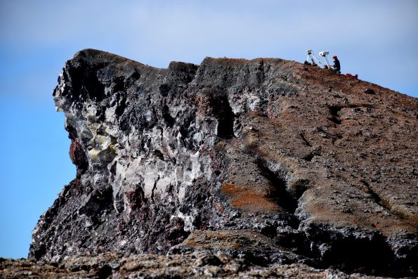 A HVO geologist at Pu'u 'Ō'ō takes GPS measurements at a webcam and thermal camera. Photo taken Friday, January 5, 2018 courtesy of U.S. Geological Survey
