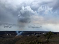 Heavy rain over the past week has created soggy conditions for fieldwork, but a brief clearing this afternoon provided good views of the summit. This photo, taken from Uwēkahuna Bluff near Jaggar Museum and the Hawaiian Volcano Observatory, shows fume rising up from the summit lava lake and condensing into a small cloud. Photo taken Sunday, February 18, 2018 courtesy of U.S. Geological Survey