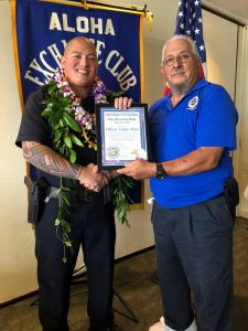 Officer Tristin Allen and Aloha Exchange Club member, John Stewart