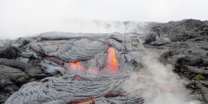 Steam rises off the active lava flow in a rainstorm. File Photo courtesy of USGS/HVO.