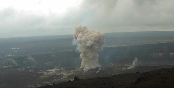 Just before noon today, HVO's summit webcam (KIcam) captured this striking image of Kīlauea Volcano's ongoing summit eruption. A small rockfall on the north side of the Overlook crater triggered a small explosion in the lava lake, sending a dark-colored ash plume skyward. Visitors (lower right) who happened to be looking toward Halema'uma'u from the Jaggar Museum Overlook in Hawai'i Volcanoes National Park witnessed the event, but were in no danger from it given their distant vantage point. Photo taken Thursday, March 15, 2018 courtesy of U.S. Geological Survey