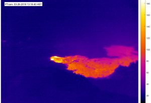 On March 25, between 10:06 and 10:08 p.m., a small lava flow began erupting onto the Pu'u 'Ō'ō crater floor for the first time since May 2016. In this thermal image, taken by the PTcam today (March 26) at 1:18 p.m., the flow (bright color) appears to be supplied by one of the small spatter cones in the crater's south embayment. The lava flow did not extend beyond the crater. This type of activity is not unusual for Pu'u 'Ō'ō, and does not reflect a significant change in the ongoing eruption. Photo taken Monday, March 26, 2018 courtesy of U.S. Geological Survey