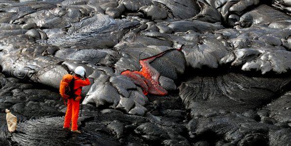An HVO geologist photographs an active pāhoehoe breakout after taking a lava sample nearby. Photo taken Friday, April 13, 2018 courtesy of U.S. Geological Survey