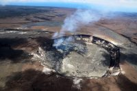 A helicopter overflight this afternoon (April 23) of Kīlauea Volcano's Halema'uma'u crater showed the extent of the largest overflow (silver gray) of the lava lake, which occurred from approximately 6:30 a.m. to 9:30 a.m. this morning. The overflow covered much of the April/May 2015 and October 2016 overflows, but a section of the 2015 overflow is still visible on the south (upper edge) of the Halema'uma'u crater floor. At the time of the flight, multiple spattering sites were active around the margin of the summit lava lake, and the lake surface had dropped to a few meters (yards) below the vent rim. The lower lake level reflected the switch from inflation to deflation at the summit of Kīlauea. Photo taken Monday, April 23, 2018 courtesy of U.S. Geological Survey