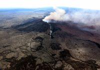 This wide shot looks northeast, and shows the fissure that formed on the west flank of the Pu'u 'Ō'ō cone (line of white steam). The fissure extends roughly 1.5 km (0.9 mi) west of Pu'u 'Ō'ō Crater, and nearly reaches the bottom of the photograph. Photo taken Thursday, May 3, 2018 courtesy of U.S. Geological Survey