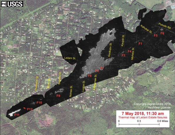 This thermal map clearly shows the fissure system during an overflight of the area this afternoon. The Fissure 8 flow is inactive, but Fissures 11 and 12 opened today. Fissure 12, which started shortly after the map was map, began around noon. The black and white area is the extent of the thermal map. Temperature in the thermal image is displayed as gray-scale values, with the brightest pixels indicating the hottest areas (whitish areas show the active lava flow). The gray linear features are the other fissures (numbered in red color) that have erupted thus far in the sequence. The thermal map was constructed by stitching many overlapping oblique thermal images collected by a handheld thermal camera during a helicopter overflight of the flow field. The base is a copyrighted color satellite image (used with permission) provided by Digital Globe.
