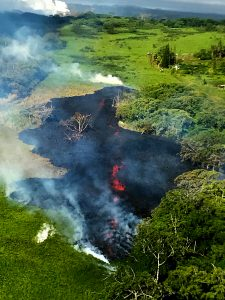 At 8:00 a.m. HST. A slow sticky a'a flow emerges from a new fissure just over a half mile northeast of the end of Hinalo Street. The new fissure - fissure 17 - is about one half mile south of Hwy 132. Some reports have referred to this fissure as number 18 but that is not correct. Fissure 18 had not erupted by this time. Photo taken Sunday, May 13, 2018 courtesy of U.S. Geological Survey