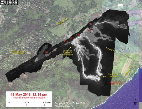 This thermal map shows the fissure system and lava flows as of 12:15 pm on Saturday, May 19. The two primary lava flows originate from the Fissure 20-22 area, and crossed Pohoiki Road over the past day. The flow front position based on a 6:40 pm update is shown by the red circle. The black and white area is the extent of the thermal map. Temperature in the thermal image is displayed as gray-scale values, with the brightest pixels indicating the hottest areas. The thermal map was constructed by stitching many overlapping oblique thermal images collected by a handheld thermal camera during a helicopter overflight of the flow field. The base is a copyrighted color satellite image (used with permission) provided by Digital Globe.