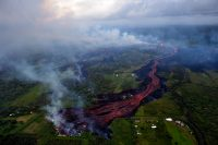 Channelized lava emerges from the elongated fissure 16-20 (in the upper right). Photo taken May 19, 2018, at 8:18 AM HST. Photo taken Saturday, May 19, 2018 courtesy of U.S. Geological Survey