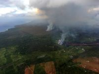 Helicopter overflight of the southeast coast of the Puna district during the early morning hours of May 19, 2018. Flows are moving downslope toward the ocean. Photograph courtesy of the Hawai`i County Fire Department. Photo taken Saturday, May 19, 2018 courtesy of U.S. Geological Survey