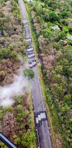 Metal plates places over cracks due to the Kilauea eruption on Pahoa-Kalapaha Road (Route 130) near Leilani Estates. Photo taken May 21, 2018 courtesy of Hawaii County Civil Defense.