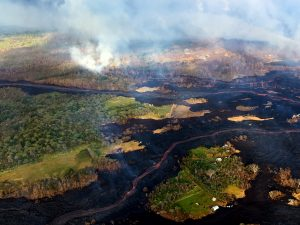 View during an early morning overflight of Kīlauea Volcano's lower East Rift Zone. Two fissures (not pictured) are sending lava down two channels that merge near the coast. Photo taken Tuesday, May 22, 2018 courtesy of U.S. Geological Survey