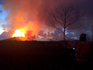 Crews make visual observations of activity at fissure 8 around 5:30 a.m. HST. Fountain heights this morning continue to reach 70 to 80 m (230 to 260 ft) above ground level. The fountaining feeds a lava flow that is moving to the northeast along Highway 132 into the area of Noni Farms road. Photo taken Thursday, May 31, 2018 courtesy of U.S. Geological Survey