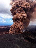 With each large earthquake, ground shaking causes additional collapse within the Pu'u 'Ō'ō crater, sending a plume of reddish-brown ash skyward. The size and vigor of a plume depends on the size of the earthquake and subsequent collapse. This roiling ash plume followed the magnitude-6.9 earthquake on May 4. Much of the rock within the crater is rust in color, which is a result of heavy alteration by acidic volcanic gases. When the rock is pulverized by a collapse event, the resulting ash plume is pink to reddish-brown ash plume. USGS photo by T. Neal.
