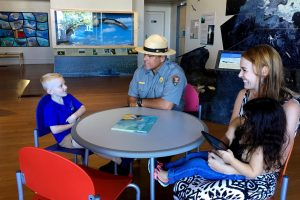 Ranger Keoni interacts with visitors at Mokupāpapa Discovery Center earlier this week. NPS Photo/Janice Wei.