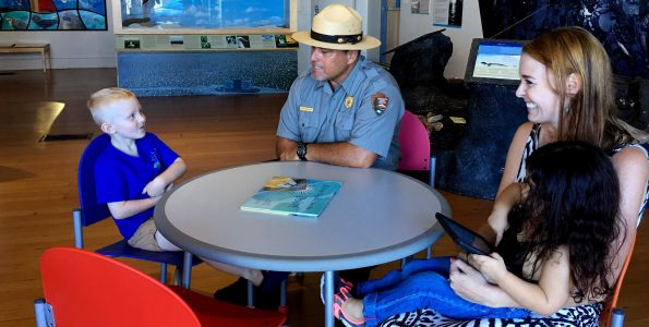 Ranger Keoni talks to visitors at MDC. NPS Photo Janice Wei-t