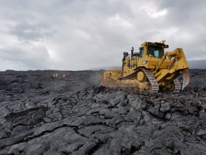 A bulldozer removes lava on Chain of Craters-Kalapana Road. NPS Photo