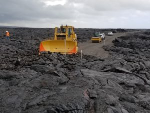 The first bulldozer on the project touches hard lava on Chain of Craters-Kalapana Road. NPS Photo