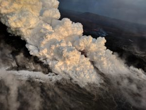 """View of the active ocean entry in the vicinity of Vacationland. The interaction of hot lava with the ocean creates """"laze"""", a corrosive seawater plume laden with hydrochloric acid and fine volcanic particles that can irritate the skin, eyes, and lungs, but that dissipates quickly with distance. Photo taken Saturday, June 16, 2018 courtesy of U.S. Geological Survey"""