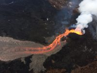 Aerial view of lava fountain at Fissure 8 and uppermost lava channel during an early morning overflight of the lava flow field. Photo taken Sunday, June 24, 2018 courtesy of U.S. Geological Survey