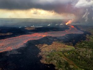 Continued eruption at Fissure 8 feeds the voluminous lava channel to the ocean as seen during this morning's overflight of the lava-flow field. Photo taken Wednesday, June 27, 2018 courtesy of U.S. Geological Survey