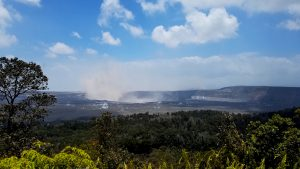 View of Kīlauea Volcano's summit. The brown visible dust coming from Halema'uma'u is from rockfalls. Photo taken Saturday, June 30, 2018 courtesy of U.S. Geological Survey