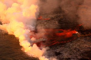 At the Kapoho coast, lava enters the ocean along the northern margin of the flow field. Photo taken Saturday, June 30, 2018 courtesy of U.S. Geological Survey