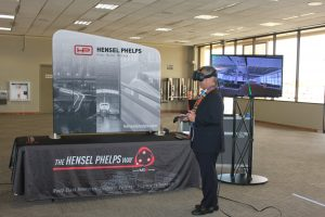 Governor David Ige experiences the virtual reality display by Hensel Phelps that shows what the Mauka Concourse will look like when it is built in 2020.