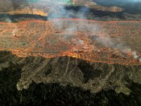 Close up image of overflows from the fissure 8 lava channel. Photograph taken during the morning overflight. Photo taken Monday, July 2, 2018 courtesy of U.S. Geological Survey