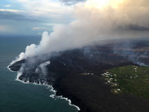 The ocean entry being fed by a crusted over channel has fewer tiny ooze-out channels than yesterday spilling into the water. One larger ooze-out channel making dominant entry plume at the northern end of the broad ocean entry. Photo taken Monday, July 2, 2018 courtesy of U.S. Geological Survey