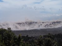 At 1:20 PM HST on July 5, a collapse explosion event occurred at Kīlauea's summit. The energy released by the event was equivalent to a M5.2 earthquake. The shaking produced rockfall from Halema'uma'u's steep crater walls (brown dust), as viewed from a temporary observation post at Volcano House. Photo taken Thursday, July 5, 2018 courtesy of U.S. Geological Survey
