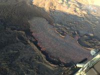"""Close view of the """"end"""" of the open lava channel where lava moves beneath the crusted 'a'ā flow. Photo taken Sunday, July 8, 2018 courtesy of U.S. Geological Survey"""